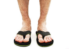 Male foot in flip-flop. On white background Stock Photos