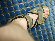 Male foot in sandale Stock Images