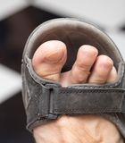 Male foot in sandals. Photos in the studio Stock Photos