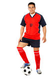 Male footballer with a football Stock Image