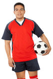 Male footballer with a football Stock Photo