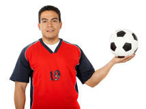 Male footballer holding a football Stock Photos