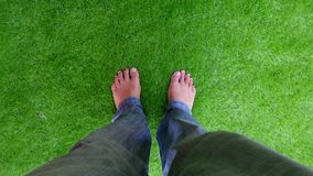 Male foots on artificial turf Royalty Free Stock Images