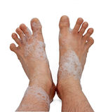 Male foots in bath foam Stock Photos