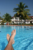 Male foots and swimming pool Royalty Free Stock Photography
