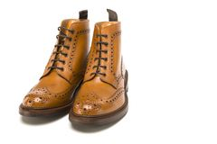 Male Footwear Ideas. Pair of  Premium Tanned Brogue Derby Boots. Made of Calf Leather with Rubber Sole. Isolated Over Pure White Background. Horizontal Image Stock Images