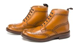 Male Footwear Ideas. Pair of  Premium Tanned Brogue Derby Boots. Made of Calf Leather with Rubber Sole. Isolated Over Pure White Background. Horizontal Image Stock Image