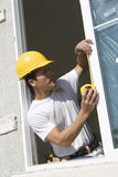 Male Foreman Taking Measure Of Window Royalty Free Stock Images