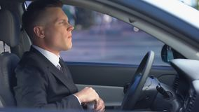 Male in formal suit taking pill on driver seat, risk of accident, painkillers. Stock footage stock video
