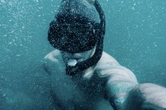 Male freediver taking selfie underwater. royalty free stock photography