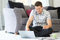 Male Freelance Worker Using Laptop At Home Stock Photography