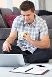 Male Freelance Worker Using Laptop At Home Royalty Free Stock Photos
