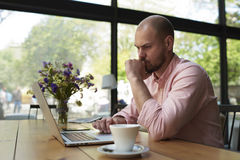 Male freelancer connecting to wireless via laptop computer Stock Photo