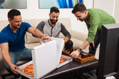 Male friends excited about pizza Royalty Free Stock Image