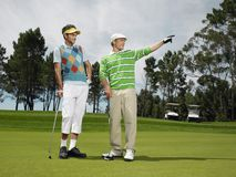 Male Friends Golfing Together Royalty Free Stock Images