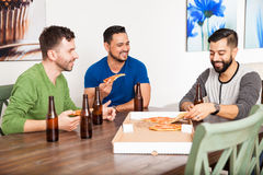 Male friends hanging out at home Stock Images