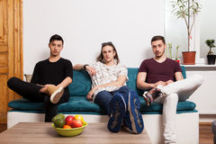 Male friends hanging out together in nice confortable room Royalty Free Stock Photos