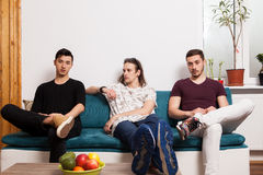 Male friends hanging out together in nice confortable room Stock Images