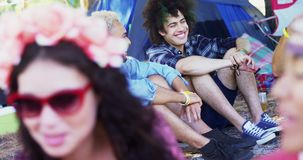 Male friends interacting with each other at music festival 4k. Happy male friends interacting with each other at music festival 4k stock video footage