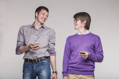 Male friends with phones in hand Stock Photography