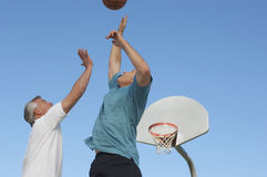 Male Friends Playing Basketball Royalty Free Stock Photos