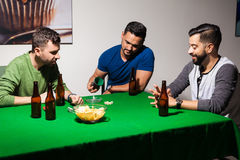 Male friends playing dice at night Royalty Free Stock Photo