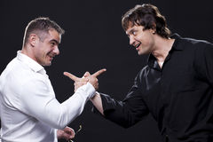Male friends pointing at each other Stock Photos