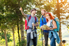 Male with friends show in distance Royalty Free Stock Image