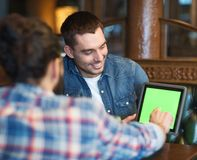 Male friends with tablet pc at bar Stock Photos