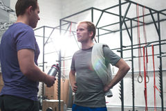 Male friends talking in crossfit gym Royalty Free Stock Photography