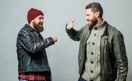 Male friendship concept. Brutal bearded men wear leather jackets. Real men and brotherhood. Friends glad see each other. Friendly relations. Friendship of stock photography