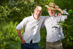 Male friendship with two senior men. Outside in nature Royalty Free Stock Photos