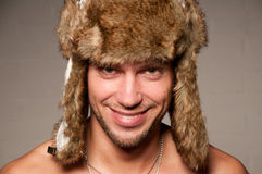 Male in fur hat Stock Image
