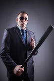 Male gangster with baseball bat Royalty Free Stock Image