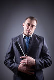 Male gangster with baseball bat Stock Photos