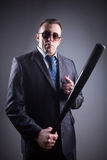 Male gangster with baseball bat Stock Images