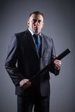 Male gangster with baseball bat Royalty Free Stock Photography