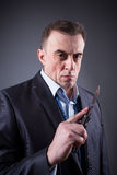 Male gangster in a business suit with a knife Royalty Free Stock Images