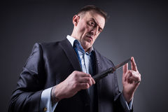 Male gangster in a business suit with a knife Stock Photos