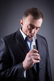 Male gangster in a business suit with a knife Stock Photography
