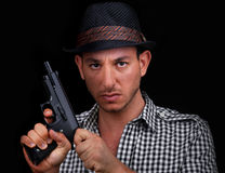 Male gangster loading gun Royalty Free Stock Images