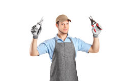 Male gardener holding pliers Royalty Free Stock Image