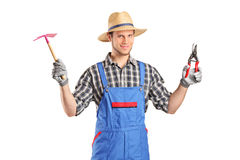 Male gardener holding working tools Stock Photography