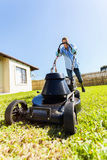 Male gardener lawnmower Stock Images