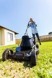 Male gardener lawnmower Stock Images