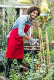 Male gardener working outside greenhouse. Portrait of male gardener working outside greenhouse Stock Images