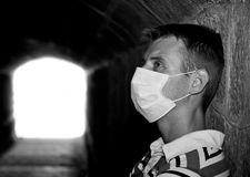 Male with Gauze bandage in dark tunnel. Man with Gauze bandage in dark tunnel (black and white Stock Image