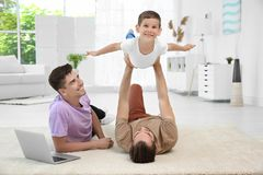 Male gay couple playing with foster son. Adoption concept Stock Photo