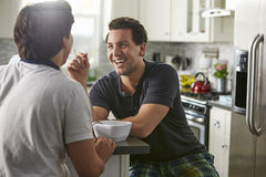 Male gay couple in their 20s talk in their kitchen, close up royalty free stock photography