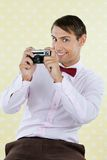 Male Geek Holding Retro Camera Royalty Free Stock Images